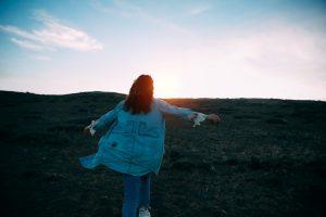 Woman walking towards her goal